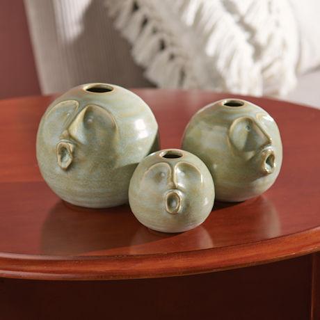Three Singers Vases